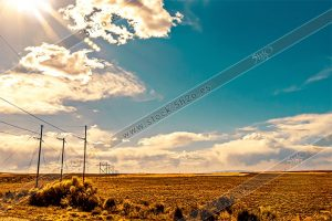 Foto de stock - Photo Stock - Nubes sobre el paramo con tendido electrico
